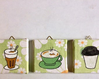 3 small paintings on canvas, cappuccino, coffee to go and latte macchiato