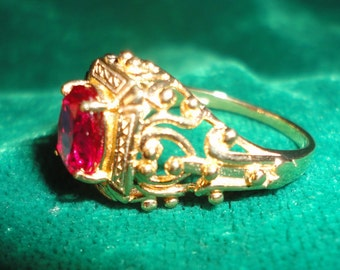 A Flawless Filigree Antiqued Gold Plated Ruby Ring******.