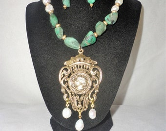 A Magnificent Renaissance Inspired Baroque Pearls Emerald Necklace Set****.