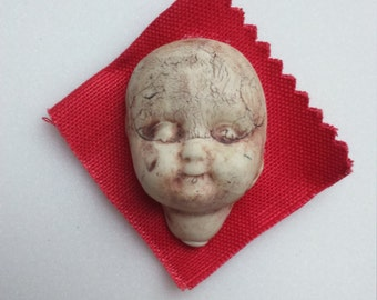 Porcelain Doll Brooch Red Fabric