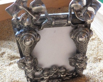 Ornate Antique Pewter Frame with Dramatic Theme
