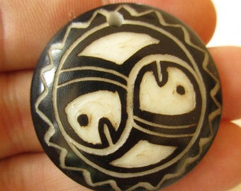 Tagua Nut Bead/Vegetable Ivory with handcarved tribal or precolombian ethnic totem. With hole for pendant.