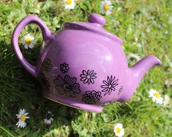 Hand drawn small purple flowers pattern porcelain teapot