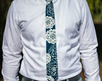 Navy skinny tie with large white floral design