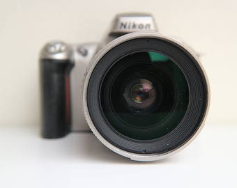 Nikon F55 SLR camera with a 28-80mm f/3.3-5.6G kit lens