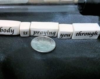 Somebody is praying you through beads