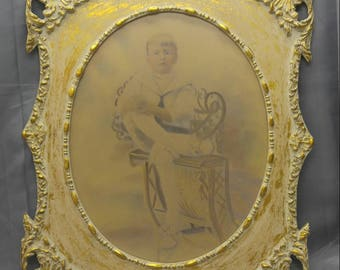 Antique old vintage picture frame with antique embellished portrait photograph of a boy