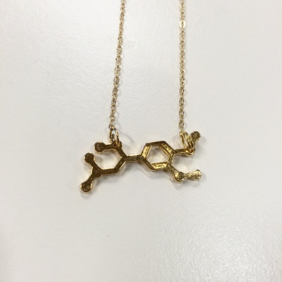 """Gold coloured adrenaline molecule necklace on 17"""" chain"""
