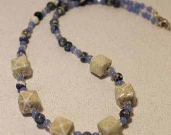 White cube beads paired with multi blue beads necklace