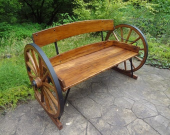 Wagon wheel bench. Very rustic, very well made.