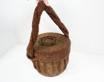 Vintage Beaded Drum Purse with Twisted Strap Design from the 1930s in Copper Brown