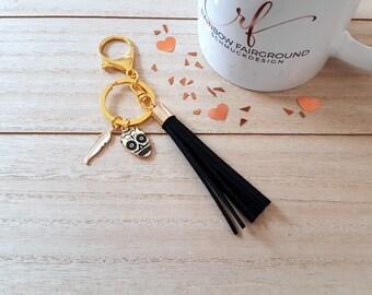 "Key ring/ring with pendant ""Skull/spring"" gold/black"