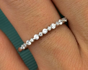 SPECIAL SETTING WEDDING band with alternative big and small simulated diamonds set in single prong set, 14 karat white gold wedding band