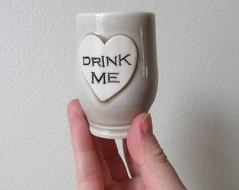 Alice in Wonderland Shot Glass 'Drink Me' heart shaped Stoneware Baby Gray