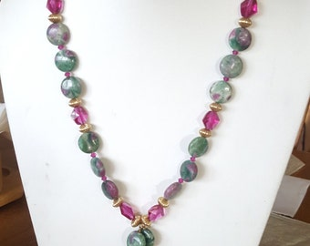 A Necklace of Fuschite/zoasite  stones that contain natural Rubies.