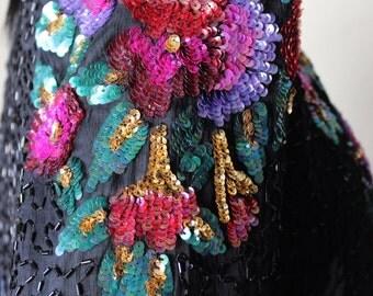Sequin short jacket, vintage, black, floral, rainbow, long sleeves, collarless. Laurence Kazar jacket
