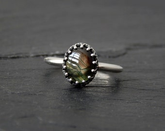 Black and Green Star Sapphire Ring in Sterling Silver: Size 7, knife-edge band, fancy Crown bezel setting, 9x7mm cabochon gemstone jewelry