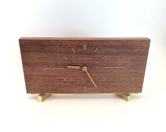 Wooden 60s trapezium shaped wind up Junghans mantel clock or table clock in teak with brass numerals and hands