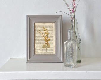 framed pressed flowers on antique book page - grey + yellow