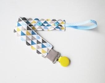 """Attache tétine sucette en tissu """"triangle bleue"""" avec clip métal et pression"""