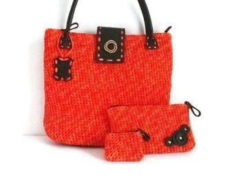 Big orange bag made with crocheted in acrylic tape and genuine leather accessories Model Pikeros 045
