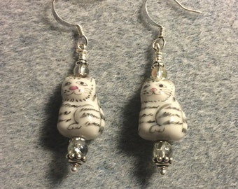 Grey striped ceramic tabby cat bead dangle earrings adorned with clear Czech glass beads.