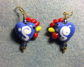Opaque blue and red heart shaped lampwork hen bead earrings adorned with blue Czech glass beads.