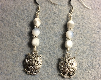 Silver owl charm earrings adorned with white and grey Czech glass beads.