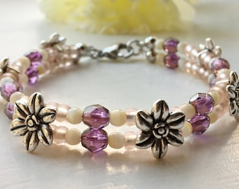 "Flower bracelet, two - row, purple, plum, pale rose pink, cream, and silver 8"" (20 cm)"