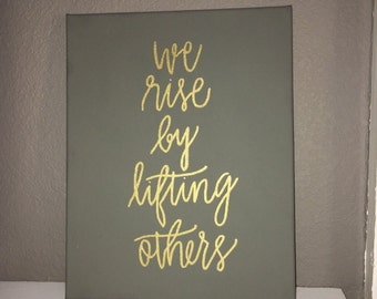 We rise by lifting others canvas