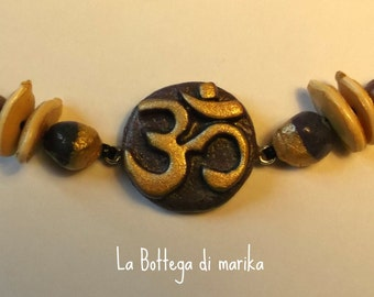 Purple necklace Om personalized with pumpkin seed corn dough and cherry pits