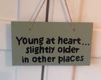 Young at heart slightly older in other places, wooden sign, hand painted sign, wall plaque, quote sign, gift for him, gift for her
