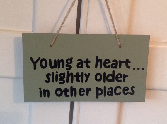 Young At Heart Slightly Older In Other Places Wooden Sign