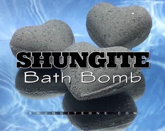 Shungite Bath Bomb. Shungite Spa & Bath treatment. Carbon infused bath fizz. Citrus powerhouse fragrance. Includes a Shungite surprise stone