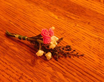 mini floral bouquet and necklace