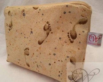 Footprints In The Sand Make Up Bag. Small make up bag with a matching zip and a white waterproof lining.