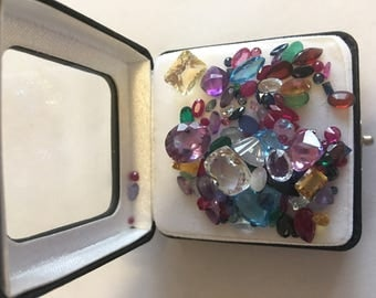 Huge lot of assorted loose gemstones from scrap gold Large Lot mostly faceted gems natural and synthetic appr. 60 carats variety of stones