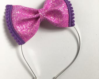 Bright purple neon purple Glitter bow, pom pom metal headband with rubber tips