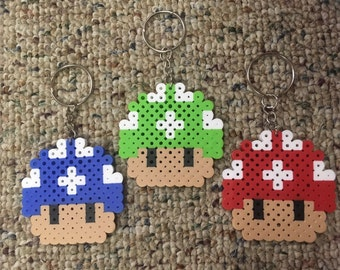 Perler Mario Mushroom in blue green red on a Keychain or Kandi bracelet