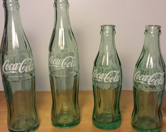 Vintage Coke bottles. Set of Four