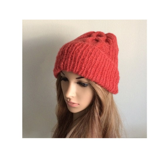 d7fe59a163e The hat is double lined and knitted with ribbed and cable stitches in coral  red color. One size stretch from 21 to 24 inches head circumference.