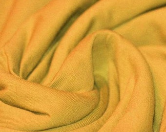 Bold Ochre Jersey Cotton Lycra mix.  Knit fabric by the half meter