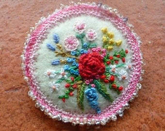 flower garden brooch hand embroidered on white wool felt with beaded and needlelace edge