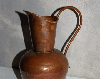 Old copper jug. Elegant piece.