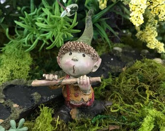 Miniature Pixie Boy Playing a Flute