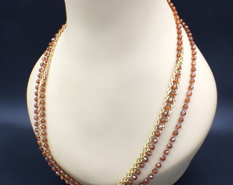Signed Hong Kong Necklace Multi Strand Amber bead and Gold Tone Anchor Chain Vintage 48""