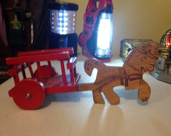 Handmade wooden toy horse and red wooden buggy