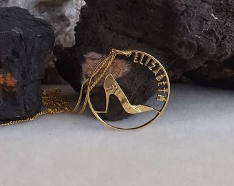 Coin jewellery - hand-cut British pre-decimal penny showing a shoe and the name 'Elizabeth' cut into the coin