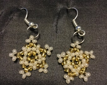Gold christmas star earrings.