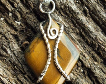 Tiger eye's magic pendant for protecting you !!!